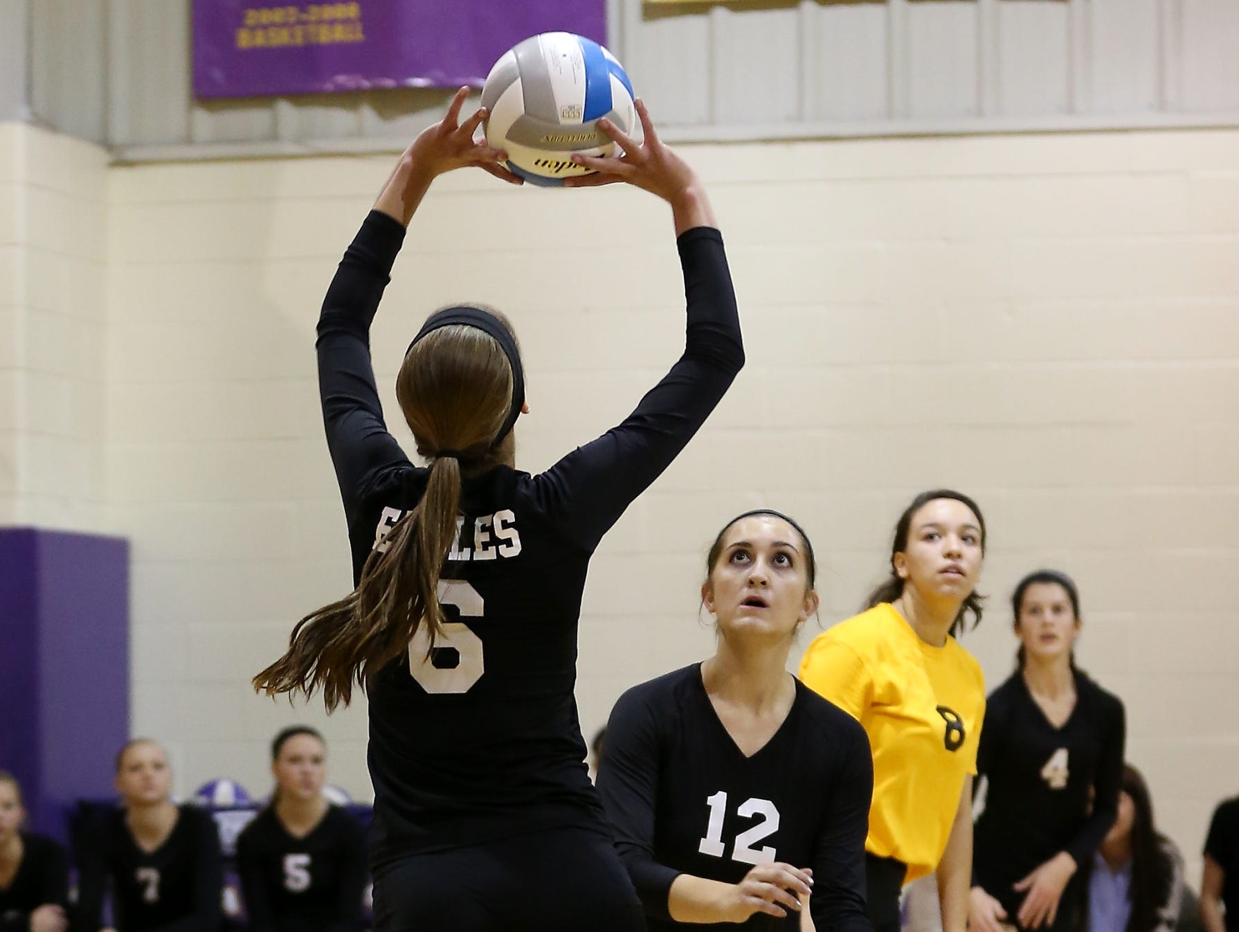 PCA's Jessica Paulson (No. 6) passes the ball to Abby Wyman (No. 12) during Thursday's Class D district final.