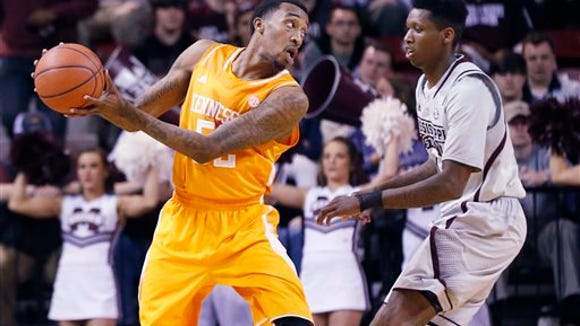 Tennessee guard Jordan McRae (52) tries to pass around