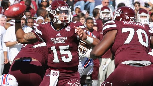 Mississippi State quarterback Dak Prescott (15) receives blocking from teammate Justin Malone (70) as he prepares to pass during the first half of a NCAA college football game against Louisiana Tech in Starkville, Miss., on Saturday, Oct. 17, 2015. Mississippi State won 45-20.(AP Photo/Jim Lytle)