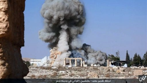 This undated photo released Aug. 25 on a social media site used by Islamic State militants, which has been verified and is consistent with other AP reporting, shows smoke from the detonation of the 2,000-year-old temple of Baalshamin in Syria's ancient caravan city of Palmyra.