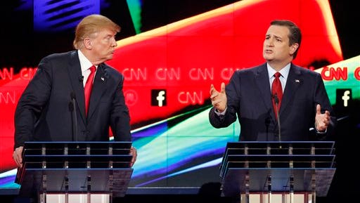 In this Dec. 15 photo, Donald Trump, left, watches as Ted Cruz speaks during the CNN Republican presidential debate at the Venetian Hotel & Casino in Las Vegas. A growing debate over America's role in promoting regime change in the Middle East is creating unusual alliances among 2016 presidential candidates that cross party lines.