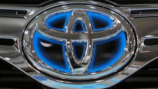 FILE - This Thursday, Nov. 10, 2011, file photo, shows the corporate logo of Toyota Motor Corp. on a vehicle on display at the company's showroom in Tokyo.