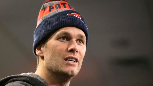 "FILE - In this Nov. 2, 2016, file photo, New England Patriots quarterback Tom Brady takes questions from members of the media during an NFL football news conference in Foxborough, Mass. Brady mocked the ""Deflategate"" scandal in an advertisement for Foot Locker released on Nov. 16, 2016."