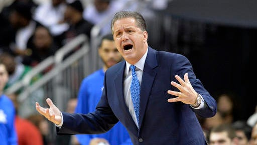 Kentucky's head coach John Calipari complains to a game official during the first half of an NCAA college basketball game against Louisville, Wednesday, Dec. 21, 2016, in Louisville, KY. (AP Photo/Timothy D. Easley)