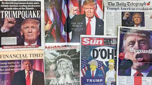 FILE - This Thursday, Nov. 10, 2016 file photo shows the front pages of various British newspapers in London reporting on Donald Trump winning the U.S. presidential election. Widely viewed as a long shot, with an unconventional campaign featuring raucous rallies and pugnacious tweets, he outlasted 16 Republican rivals. Among the Democrats, Hillary Clinton beat back an unexpectedly strong challenge from Bernie Sanders, and won the popular vote over Trump. But he won key Rust Belt states to get the most electoral votes, and will enter the White House with Republicans maintaining control of both houses of Congress. (AP Photo/Tony Hicks)