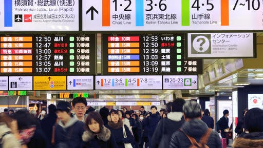 In this photo taken Jan. 14. 2017, people walk around at Tokyo Station in Tokyo. Tourism to Japan is booming, with 1 million Americans among the country's more than 20 million annual visitors. But language barriers and cultural differences may seem intimidating to some travelers.