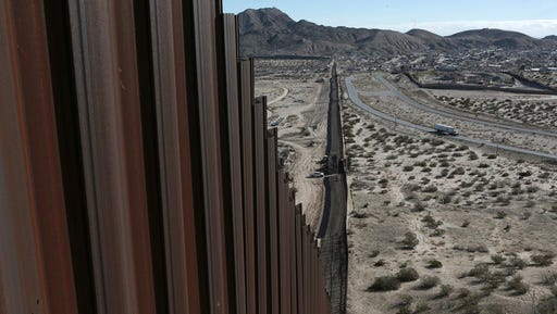 """FILE - In this Wednesday, Jan. 25, 2017 file photo, a truck drives near the Mexico-US border fence, on the Mexican side, separating the towns of Anapra, Mexico and Sunland Park, New Mexico.  U.S. Customs and Border Protection said Friday, Feb. 24, 2017 that it plans to start awarding contracts by mid-April for President Donald Trump's proposed border wall with Mexico, signaling that he is aggressively pursuing plans to erect """"a great wall"""" along the 2,000-mile border."""