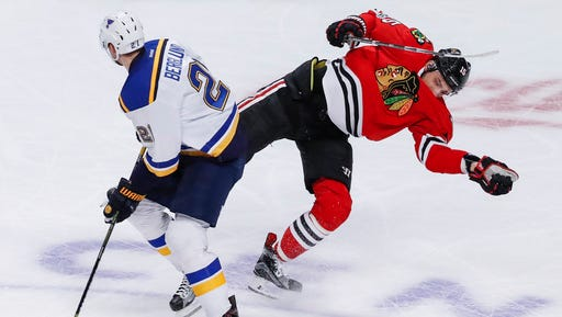 Chicago Blackhawks center Artem Anisimov, right, collides with St. Louis Blues center Patrik Berglund, left, during the second period of an NHL hockey game Sunday, Feb. 26, 2017, in Chicago. (AP Photo/Kamil Krzaczynski)