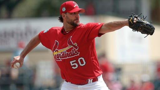 St. Louis Cardinals starting pitcher Adam Wainwright (50) works in the first inning of a spring training baseball game against the Atlanta Braves, Thursday, March 2, 2017, in Jupiter, Fla. (AP Photo/John Bazemore)