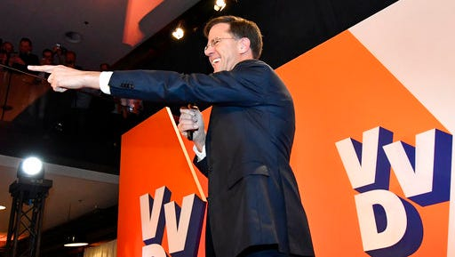 Prime Minister Mark Rutte of the free-market VVD party celebrates after exit poll results of the parliamentary elections were announced in The Hague, Netherlands, Wednesday, March 15, 2017.