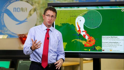 FILE- In this Oct. 5, 2016 file photo. National Hurricane Center director Rick Knabb speaks during a televised forecast regarding the threat of Hurricane Matthew in Miami. Knabb resigned as the center director and is returning to The Weather Channel as an on-air hurricane expert. Knabb has been the director of the National Hurricane Center in Miami since 2012.