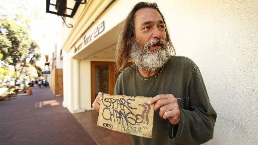 Michael Joe Coleman, 56, has been panhandling on State Street in Santa Barbara, Calif., for more than 20 years. In Kalamazoo, officials have approved a change to panhandling rules to give people seated in public places the right to be left alone.
