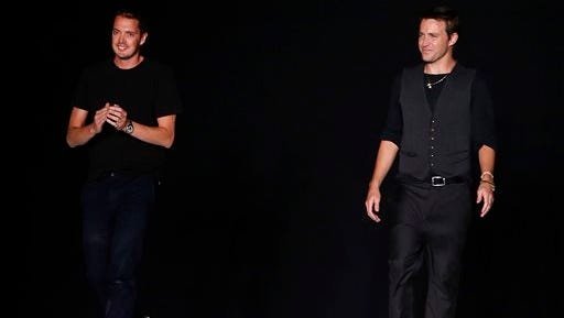 Designers Marcus Wainwright, left, and David Neville acknowledge the audience after the Rag & Bone Spring 2015 collection show during Fashion Week, Monday in New York.