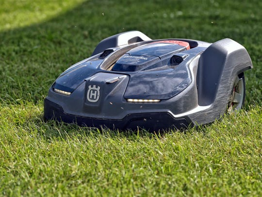 In this Wednesday, June 7, 2017 photo, a robotic mower