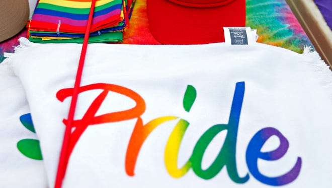 Pride merchandise sits in a booth during the 2016 Greater Ozarks Pridefest at Park Central Square in Springfield, Mo. on June 17, 2016.