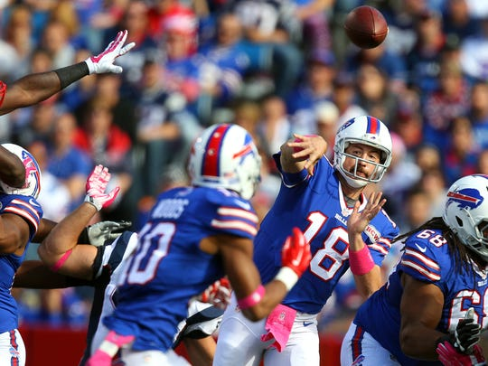 Bills QB Kyle Orton stands in the pocket and delivers the ball to receiver Robert Woods (10).