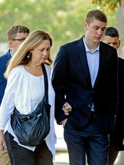 Brock Turner (right) makes his way into the Santa Clara Superior Courthouse in Palo Alto, California, on June 2. He received a six-month jail sentence for raping a young woman.