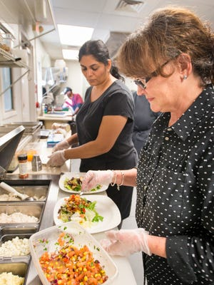 Owner Jo Heckler, right, and Gayathri Ganapathy create salads Wednesday, Nov. 15, 2017, in the kitchen at the new Jo's...as always at duh in Pensacola.