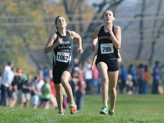 York Suburban's Olivia Gettle, left, and Palmyra's Maria Tukis battle down the final stretch for first place. at the PIAA District 3 Championship on Oct. 24, 2012. Gettle would finish third and Tukis first. (GAMETIMEPA.COM -- FILE)