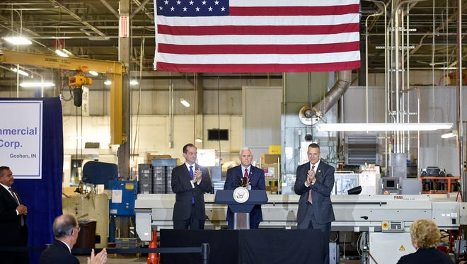 U.S. Vice President Mike Pence, center, addresses tax reform while flanked by U.S. Secretary of Labor Alex Acosta, left, and U.S. Rep. Scott Perry, R-York County, Nov. 4, at Military & Commercial Fasteners Corp. in Manchester Township, York County, Pennsylvania.