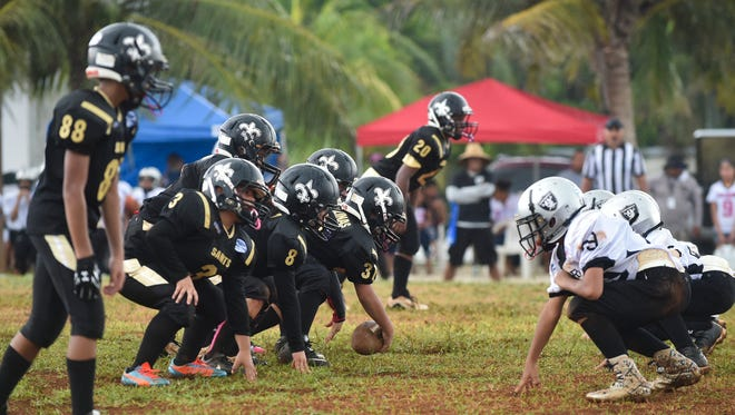 In this Aug. 21 file photo, the Cinnabon Island Saints played the Benson Raiders in a Guam National Youth Football Federation Metgot Division game at Eagles Field. The GNYFF playoffs are on Saturday.