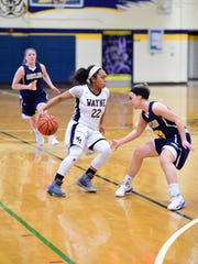 Wayne Memorial senior guard Camree Clegg (22) goes