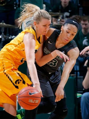 Michigan State's Aerial Powers, right, knocks the ball away from Iowa's Kali Peschel Saturday, Jan. 16, 2016, in East Lansing, Mich. Michigan State won 80-73.