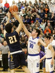 Jerry Stoddart of Mars takes a shot as Nick Juan of Horseheads defends Wednesday during the Josh Palmer Fund Elmira Holiday Inn Classic at Elmira High School.
