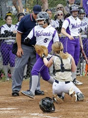 Notre Dame catcher Hannah Mahon tags out Bailey Mudge