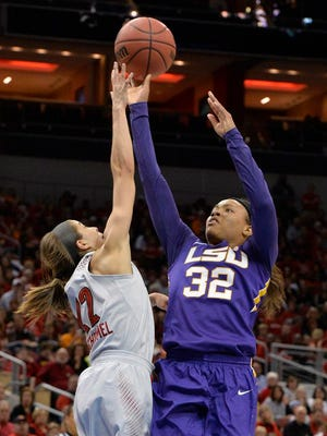 LSU's Danielle Ballard, right, puts up a shot over the defense of Louisville's Jude Schimmel during the first half in a regional semifinal at the NCAA women's basketball tournament Sunday.      AP