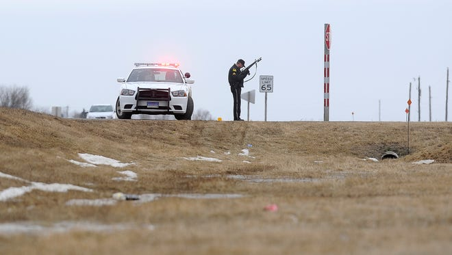 Police respond to shootings at an industrial park in Lennox on Thursday.