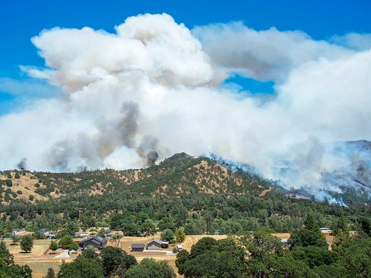 The Pawnee Fire burns down the mountain near Spring Valley, Calif., on Monday, June 25, 2018 in Lake County.