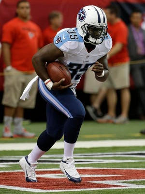Titans running back Antonio Andrews warms up for the game against the Falcons.
