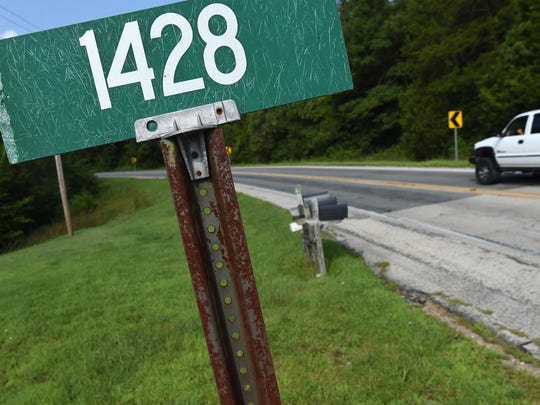 A vehicle travels on AR Highway 201 near County Road 1428 on Monday morning. Officials are continuing an investigation into what they say appears to be a murder-suicide at a residence shared by Terry Mills and Sandra Douglas.
