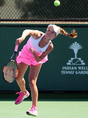 Katie Swan, 16, of Wichita, Kansas, hits a serve to opponent Morgan Coppoc of Oklahoma on Wednesday, April 8, 2015 during an Easter Bowl match at the Indian Wells Tennis Garden. Swan started playing tennis when she was 7.