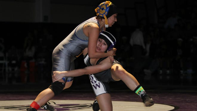 Shadow Hills High's Veronica Liebanos (on knee) wrestles Brawley High's Clarissa Jones during the first-ever girls-only dual wrestling meet held in the valley and at Shadow Hills High School in Indio on Thursday, January 21, 2016.