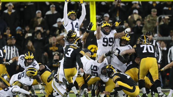 Michigan defenders attempt to block the game winning field goal by Iowa's Keith Duncan in the final seconds of U-M's 14-13 loss Saturday, Nov. 12 in Iowa City, Iowa.