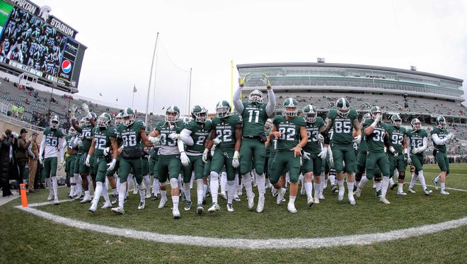Michigan State Spartans take the field prior to their game against the Ohio State Buckeyes at Spartan Stadium.