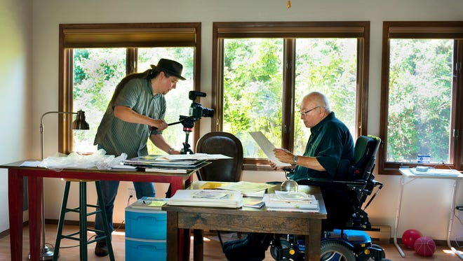 "Videographer Charles ""Boots"" Kennedye captures footage of N. Scott Momaday reading from his work at the author's home in Santa Fe."