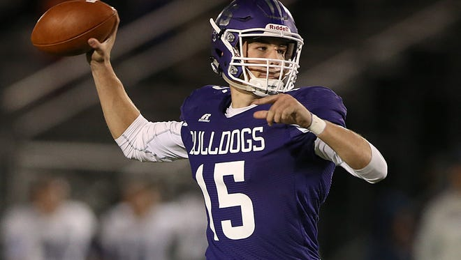 Clemson recruit Hunter Johnson (15) throws a pass for Brownsburg in a playoff game against Ben Davis on Oct. 28, 2016.