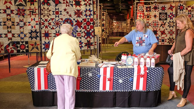 Two spaces have been opened up to display the 9/11 World Trade Center Memorial Quilt Project at the Meridian Mall Sunday, Sept. 10, 2017. The event, which shows 200 of the 300 quilt panels runs through Monday.