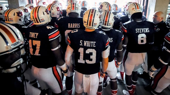 Auburn Tigers quarterback Sean White (13) and his teammates prepare to take the field prior to the game between the Auburn Tigers and the Jacksonville State Gamecocks at Jordan Hare Stadium. Mandatory Credit: Shanna Lockwood-USA TODAY Sports