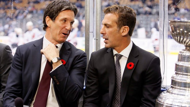 Brendan Shanahan (left) and Chris Chelios chat before Friday's Hall of Fame game in Toronto.