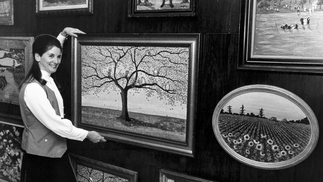 February 3, 1970 - Mrs. Giles Coors Jr. of 4247 Chanwil places one of her paintings in an art gallery at City Hall near Mayor Henry Loeb's offices on Feb. 3, 1970. Mrs. Coors, a housewife and mother of three children, is exhibiting the first of a series of art displays by Memphis artists. Mayor Loeb says he is hopeful for active participation in the displays by local artists.