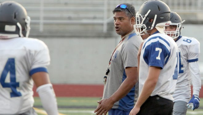 Olympic football head coach Sal Quitevis talks with his players during preseason.