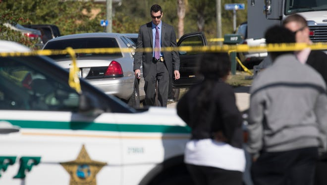 Members of the Lee County Sheriff's Office investigate the scene of a homicide at 1107 Adeline Avenue in Lehigh Acres.