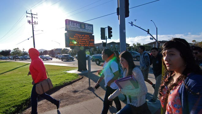 Students stream across Williams Rd. on their way to Alisal High School in Salinas.