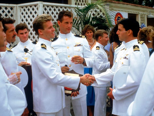 Val Kilmer and Tom Cruise (shaking hands) in 'Top Gun.'