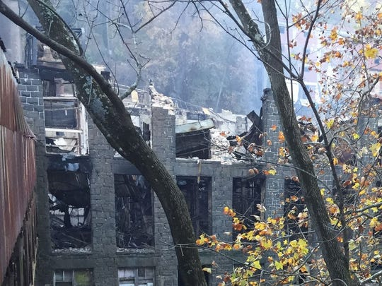 Rubble from a portion of the Bancroft Mills factory facade lies near the Brandywine in Wilmington about a week after a fire destroyed much of the complex.