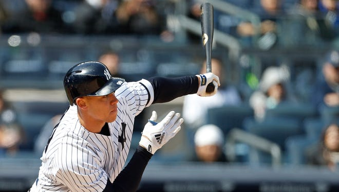 New York Yankees right fielder Aaron Judge (99) hits an RBI ground out against the Baltimore Orioles during the fifth inning at Yankee Stadium.